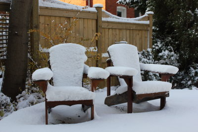 Muskoka chairs in snow
